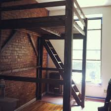 loft bed with stairs with rustic wooden design and expose