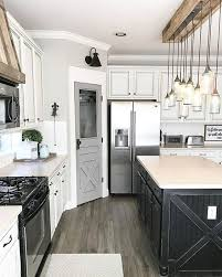 White Kitchen Black Island 15 Gorgeous White Kitchens With Coloured Islands The Happy Housie