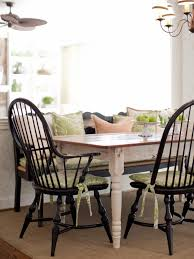 this country dining setting features a farmhouse table with black