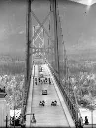 motorcade crossing the lions gate bridge during visit of king