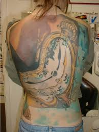 marvelous golden dali clock tattoo design for men tattooshunter com