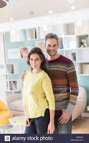 colors close to yellow portrait of a nice middle aged couple standing close to each other