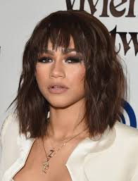 zendaya coleman medium wavy cut with bangs zendaya coleman