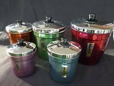 vintage canisters set tins decoware cream color red lids