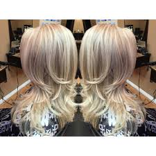platinum blonde icy long hair with blonde highlights and lowlights