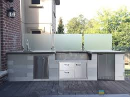 m e contracting outdoor kitchen stone veneer frosted glass
