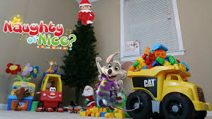 chuck e cheese and elf on the shelf put up our christmas tree