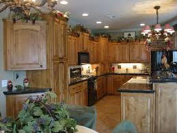 what color flooring goes with alder cabinets knotty alder cabinets with fruitwood stain kitchen wall