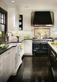 white kitchen with black floor kitchen and decor