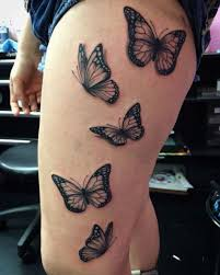 of black and gray butterfly on thigh and leg