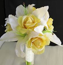 yellow lilies touch yellow roses and calla lilies bouquet
