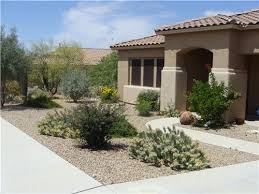 Modern Front Yard Desert Landscaping With Palm Tree And Walls Interiors Simple Front Yard Desert Landscaping Ideas With