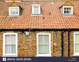 a house front roof tiles and dormer windows inset into the roof