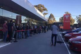 huge lines are forming around the world to order a tesla model 3