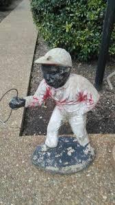 black lawn jockey statue history school cement yard porch