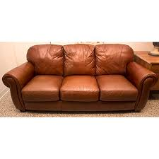 lane leather master sofa with fluffy rounded back cushions