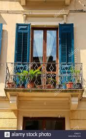 wrought iron balcony withfrench doors wooden shutters verona