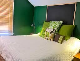 dark green bedroom walls black curtains pink mattress white