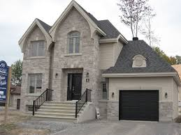 build new homes detached home with stone and vinyl cladding home construction