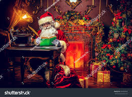 santa claus makes list gifts sitting stock photo 541043443