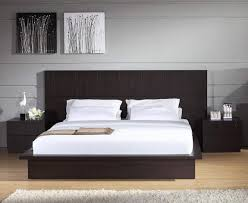 small interior bedroom with black bed frame modern king size bed