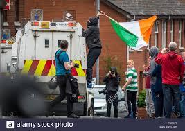 irish republican protester places an irish tricolour flag on top