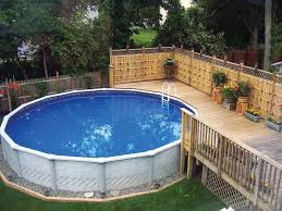 above ground pool deck with screens and planters decorating your