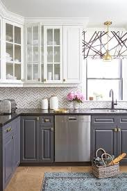 gray and white cabinets in kitchen glass front cabinets and gray lower cabinets with