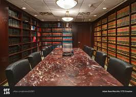 marble conference room table inside a law library conference room with long marble table stock