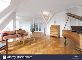 beautiful apartment living room with fish bone parquet and piano in beautiful