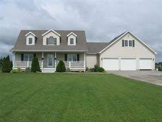 cape cod house plans with attached garage pin by on lake breezeway attached garage