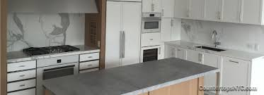 gray kitchen cabinets with white marble countertops countertops nyc countertops nyc supplying and installing