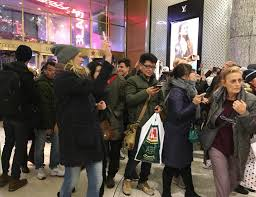 crowds shop their calories from thanksgiving on black friday