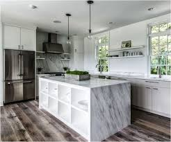 marble kitchen island table kitchen waterfall countertop hides a shelving unit inside the