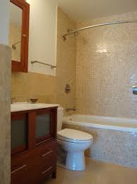 curved shower rod in bathroom contemporary with tile behind toilet