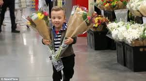 strangers flowers boy with dwarfism walks around mall handing out flowers to