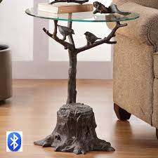 three branches support a glass table top above and two courting