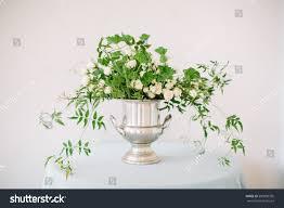 white green flower arrangement silver vase stock photo 590800355