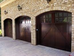 Costco Garage Doors Prices by Outdoor Arched Costco Garage Doors With Wall Sconces Also Brick