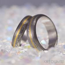damascus steel wedding band with a gold line mens engagement