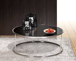 black glass top round cocktail table with stainless steel frame on