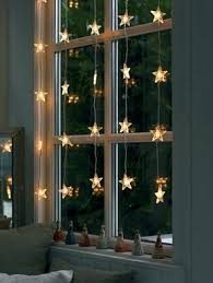 window decoration ideas with garlands candles and