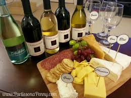 wine bottle cheese plate on a wine and cheese pairing with two buck chuck