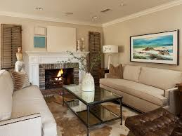 clean glass fireplace doors living room remodel built in sofa white wainscoting tailored clean
