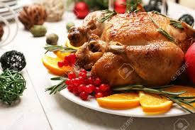 baked chicken for festive dinner christmas table setting stock