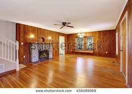 unfurnished living room wood paneling stock photo 94707913