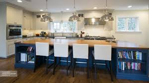 off white cabinets with a blue kitchen island omega