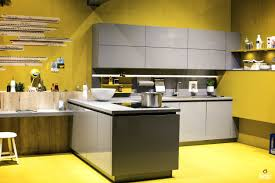 gray modular shelving cherful kitchen in yellow backdrop and floor
