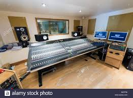 recording studio workstation desk inside a music recording studio with mixing desk and recording