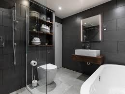 bathroom large minimalist kids doorless shower dark wood cabinets
